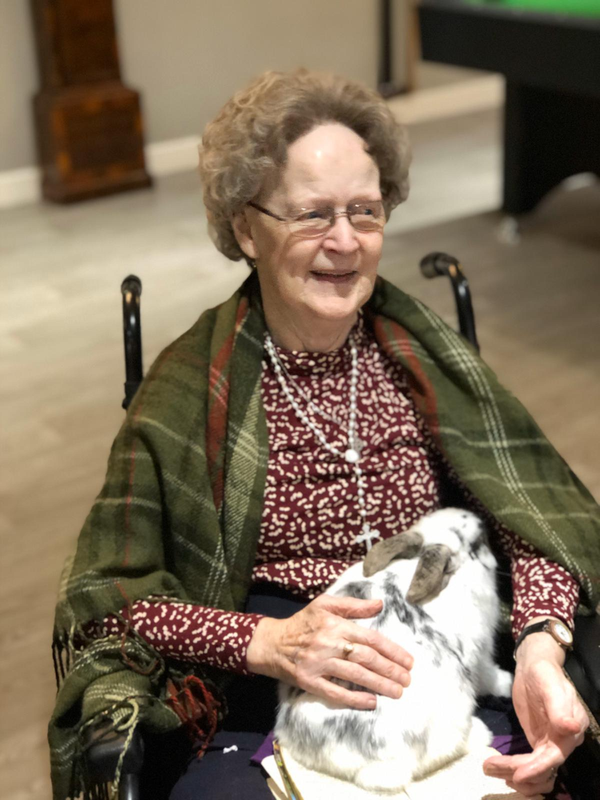 Nellie holding snowball the bunny rabbit