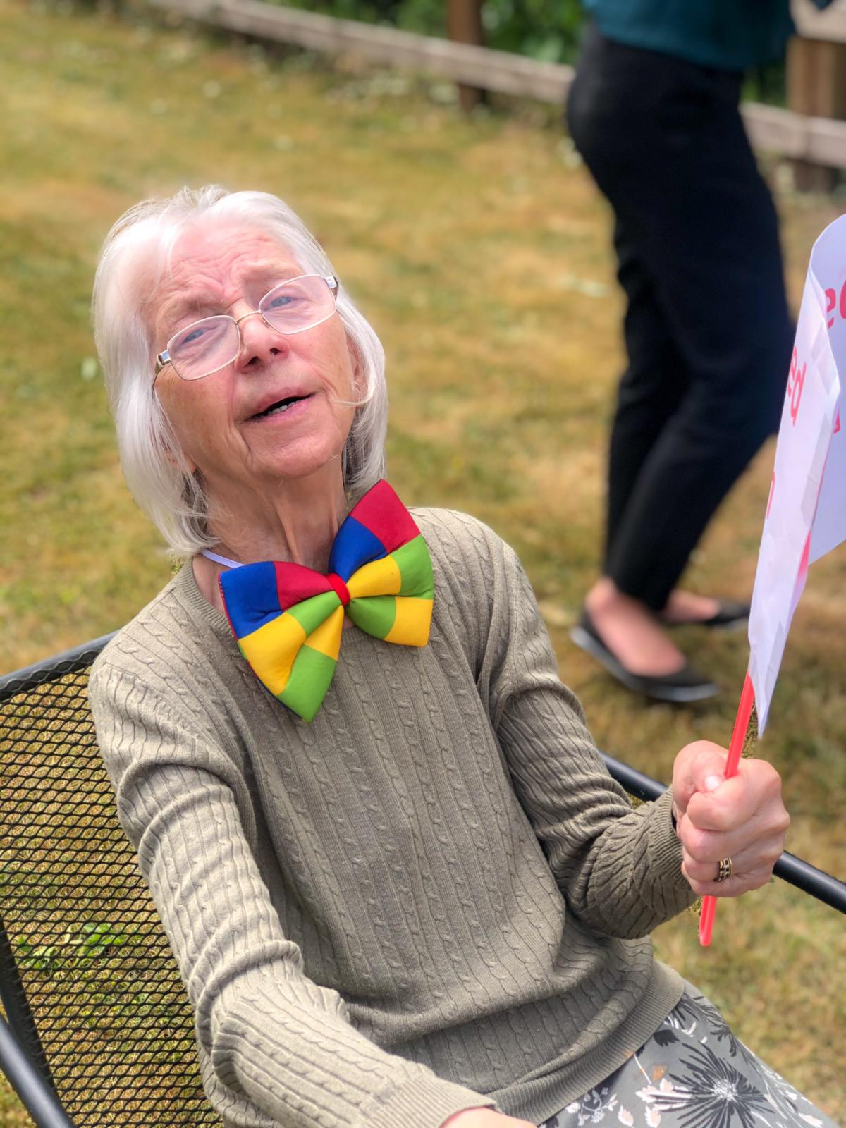 Sally enjoying sports day in a clown bow tie