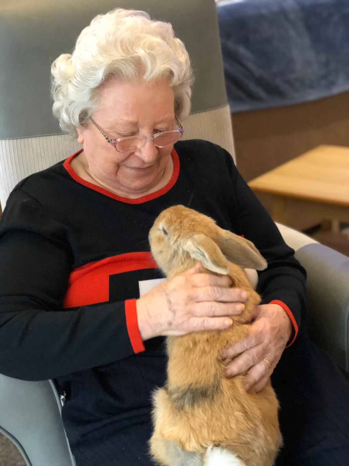 Pauline holding Flopsy the Rabbit